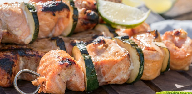 delicious grilled salmon kebab with a zucchini